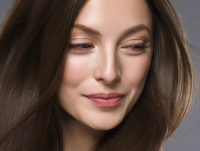 Beautiful hair woman long brunette hair beuty skin make up. Studio shot.